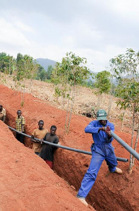 Men Connecting Pipeline in Africa 2