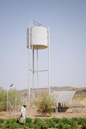 Solar Panels and Water Tank Near Garden