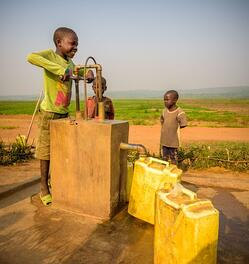 Children pumping water