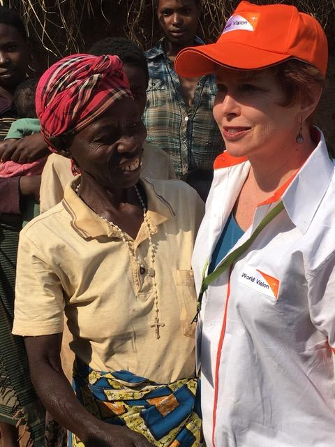 Robin connecting with a mother in Rwanda