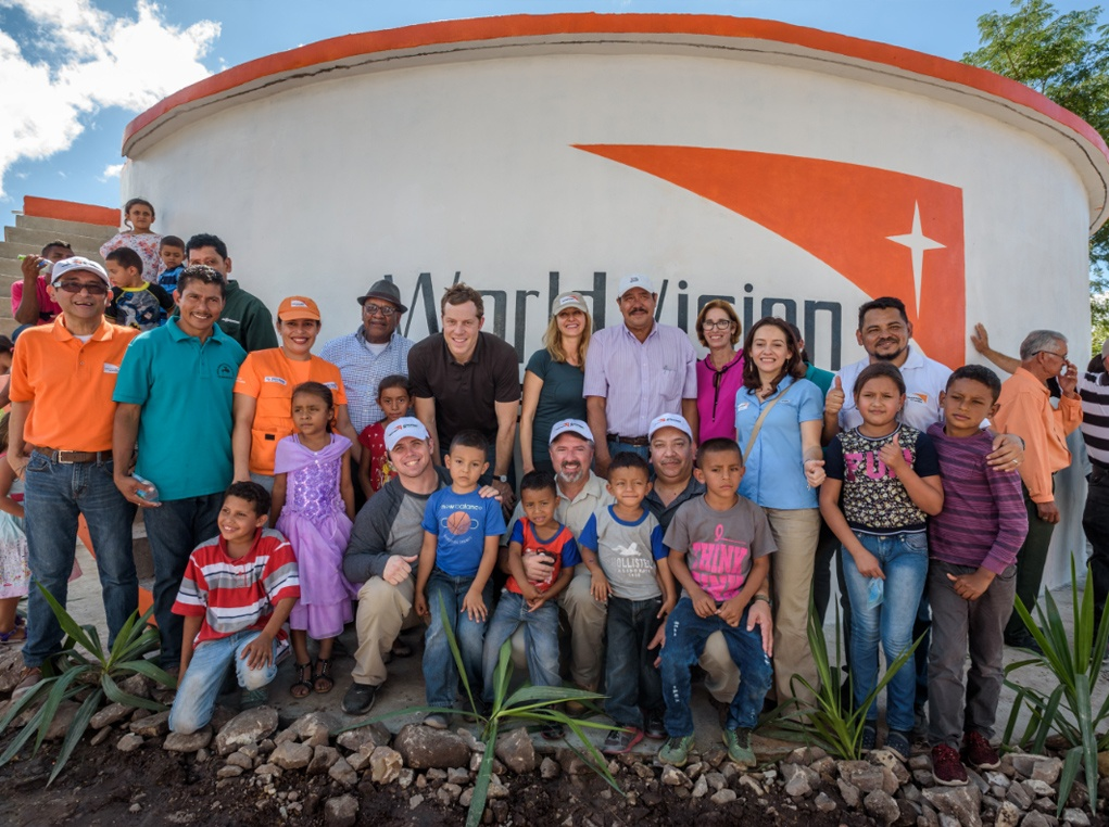 Cody Nath and other RTI employees celebrate the opening of a water system in Honduras that they funded in partnership with World Vision.