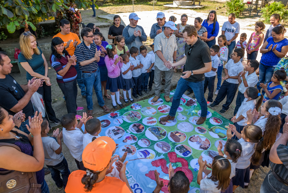 Cody playing a Sesame Street WASH game at a school that received clean water. The game helps children learn good hygiene habits.