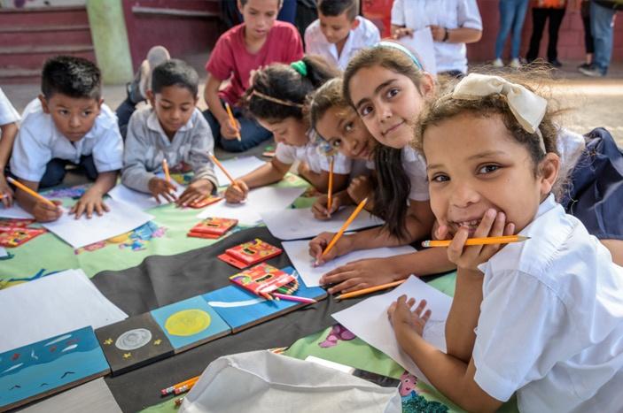 "School children take part in a lesson from the ""Raising Children with Tenderness"" curriculum, in Cerro de Plata ADP, Tegucigalpa, Honduras."