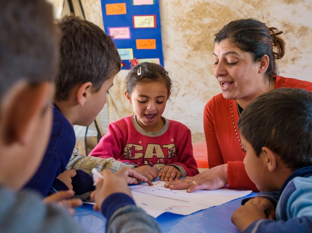 World Vision Early Childhood Education (ECE) Supervisor Thanaa supervises teaching of Syrian refugee children at an Early Childhood Education program.